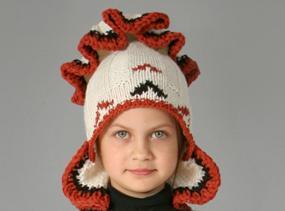 Vienetinė autorinė vilnonė vaikiška kepurė su baltų ornamentais 10-12m. mergaitei